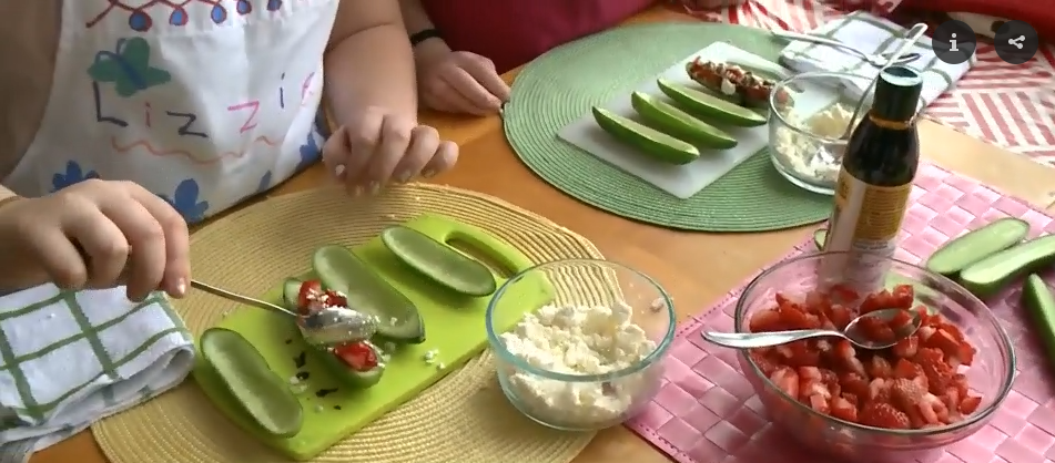 Kids making Strawberry Cucumber Boats recipe
